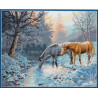 Konie zimą nad rzeką